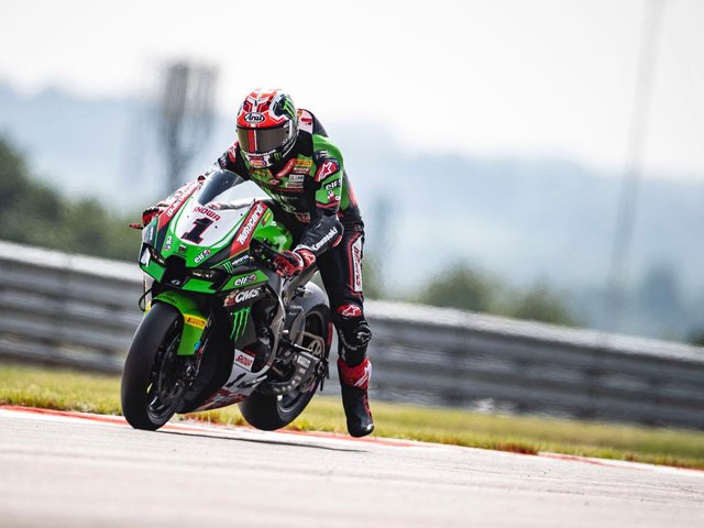 Jonathan Rea finished second in the opening World Superbike race of the weekend at Donington Park.