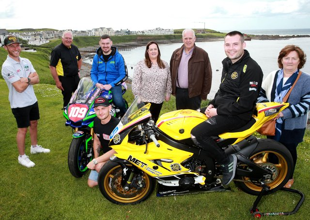 Armoy course clerk Bill Kennedy MBE (black polo shirt) with Vincent (centre) and Kathleen (far right) McAlonan and their daughter (Sean's mum - centre) Briege Crawford. Also included in the photo are road racers (L to R), Davey Todd, Neil Kernohan, Joey Thompson and Darryl Tweed