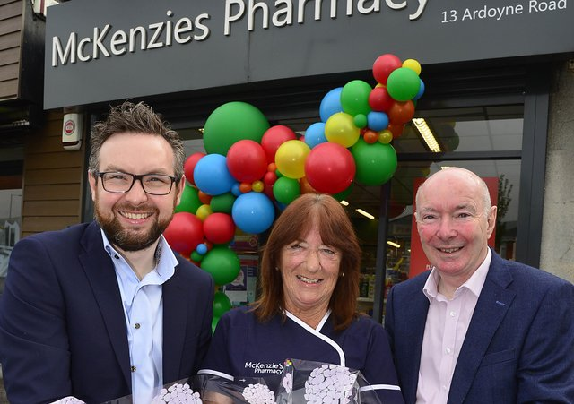 Peter Rice, Isabel Keenan and Adrian Rice outside McKenzie's Pharmacy