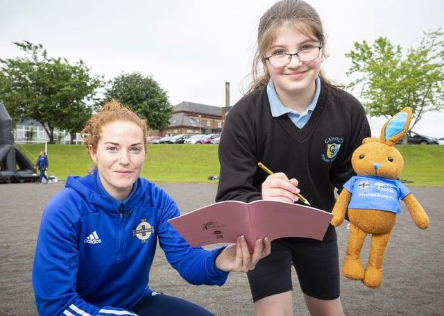 Nine-year-old Sarah Dickson with Northern Ireland International women's captain Marissa Callaghan