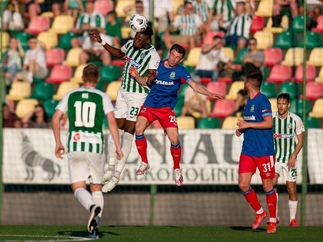 Stephen Fallon challenges for the ball