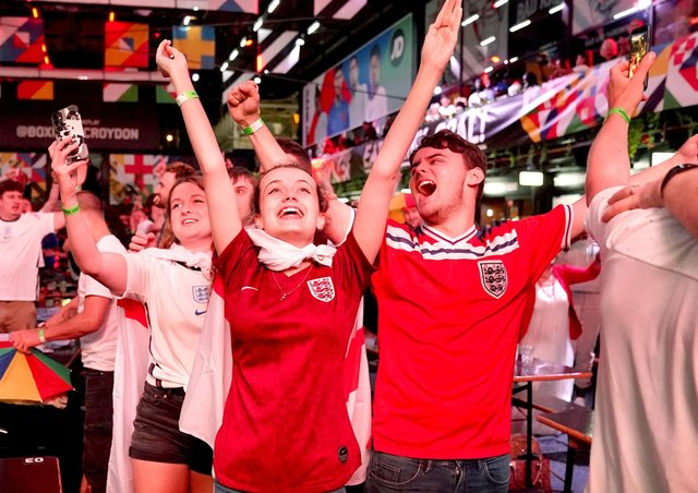 Fans at BOXPARK in Croydon celebrate England reaching the final after watching the Euro 2020 semi final match between England and Denmark. Picture date: Wednesday July 7, 2021. PA Photo. See PA story SPORT England. Photo credit should read: Tess Derry/PA Wire.