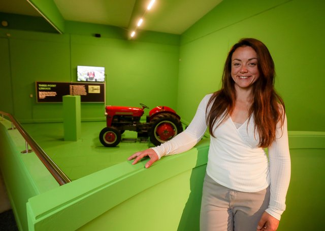 Clare Ablett, curator of history at National Museums NI with a display showcasing Harry Ferguson,  inventor of the revolutionary three-point linkage for tractors