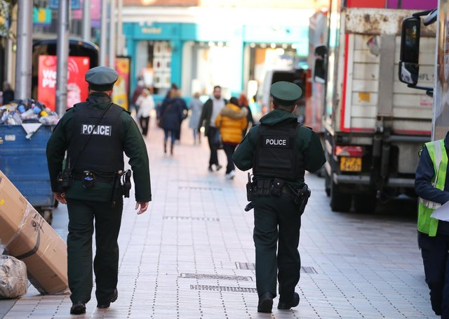 PSNI officers out walking in Belfast. Technology is no substitute for feet in the street