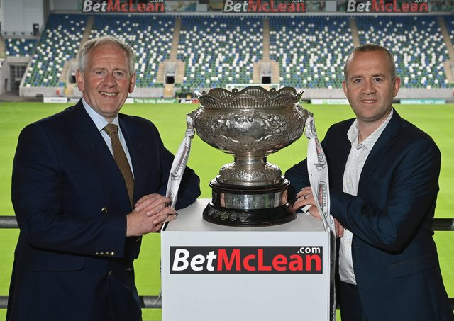 Paul McLean (BetMcLean) and Steven Mills (NI Football League) at the announcement of theextension of BetMcLean's sponsorship of the League Cup for a further three seasons.
