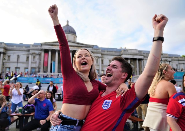Fans in Trafalgar Square, London, celebrate Harry Kane's first goal as they watch the Euro 2020 quarter final match between England and the Ukraine. Picture date: Saturday July 3, 2021