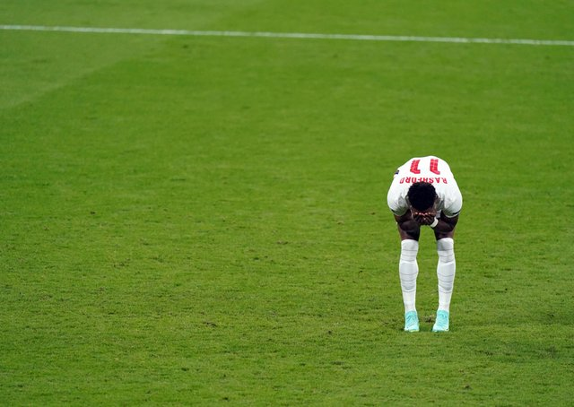 England's Marcus Rashford stands dejected after missing from the penalty spot during the UEFA Euro 2020 Final at Wembley. PA Photo
