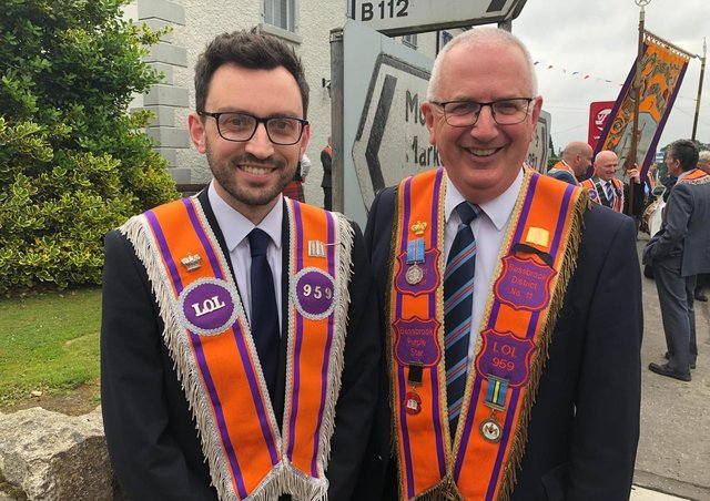 Danny Kennedy with his son Stephen on the Twelfth in Bessbrook