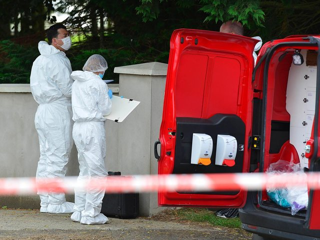 PSNI forensic officers pictured at the scene of the murder on Tuesday.
