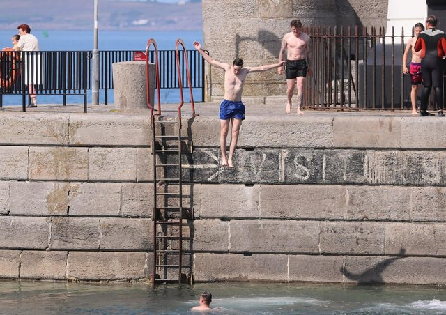 People having a splash at Donaghadee Harbour