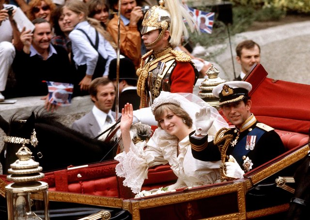 File photo dated 29/07/81 of the Prince of Wales and his bride, the Princess of Wales, making their way to Buckingham Palace in an open-top carriage after their wedding ceremony at St Paul's Cathedral in London. Picture: PA Wire