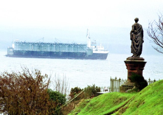 The statue of Highland Mary looks out over the Holy Loch at Dunoon as a large ship passes in February 1992.