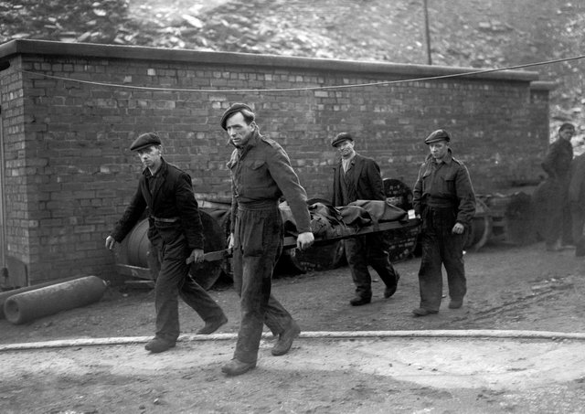 Rescue workers bring a body to the surface at Whitehaven pit where an explosion trapped 15 miners underground in August 1947. Picture: PA