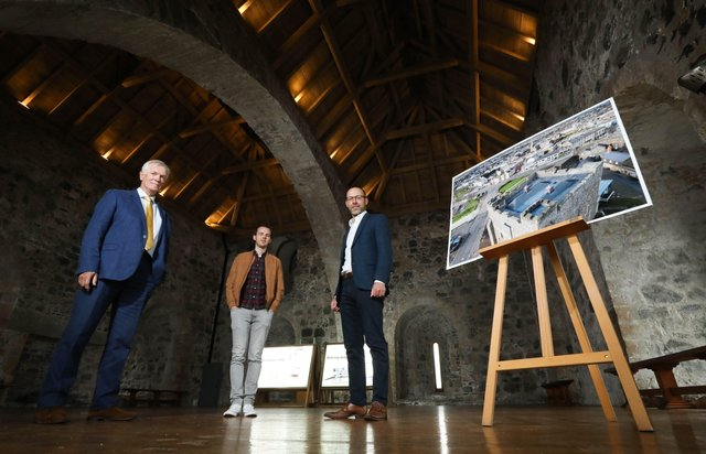 From left: Dermot MacRandal from the Department for Communities, Historic Environment Division, Andrew Bryce from Alastair Coey Architects and Ciaran Fox from RSUA celebrate winning an RSUA Design Award for the Carrickfergus Castle roof replacement project