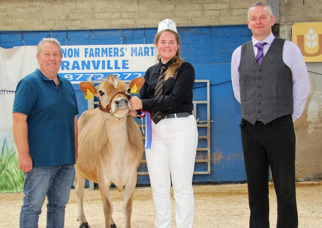 Aisla Fleming, Seaforde, was the supreme champion in the Jersey showmanship section at the 18th Multi-Breed Dairy Calf Show, held at Dungannon. Adding their congratulations are Mark Logan, Ulster Jersey Cattle Club; and judge David Gray. Picture: Julie Hazelton