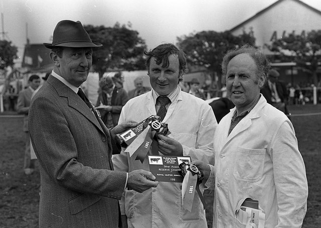 Major General E G D Pounds. Chief executive of the British Friesian Cattle Society, handing over the societyâ€TMs awards to exhibitors of the champions at the Balmoral Show in 1981. They included Mr Austen Alexander, supreme, and Mr David Heenan, reserve. Picture: Farming Life archives