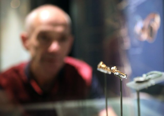 Dr Greer Ramsey, curator of archaeology at National Museums NI, with some of the gold rings found at Murlough